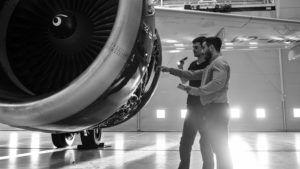 men looking at airplane