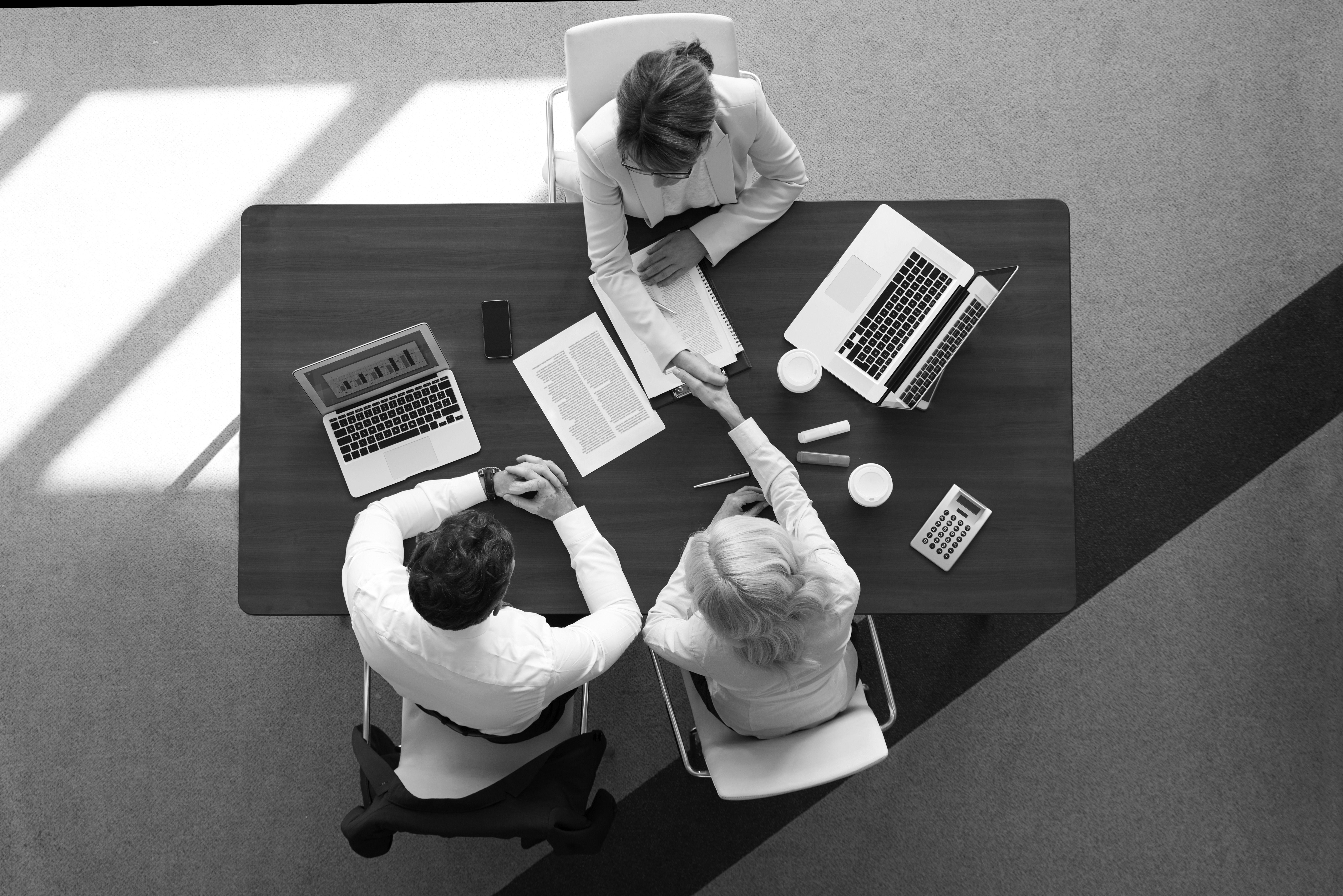 people talking at desk in office