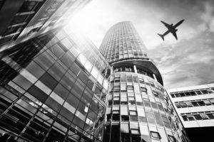 building with airplane flying overhead