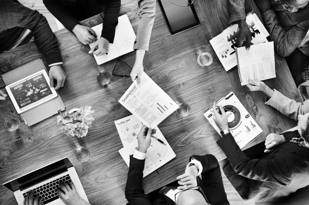 consultants in group working at desk