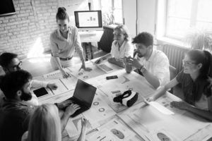 professional consultants in group working at desk