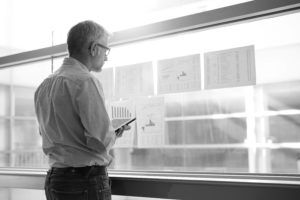 man staring at charts