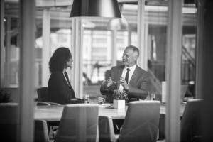man talking to woman at desk