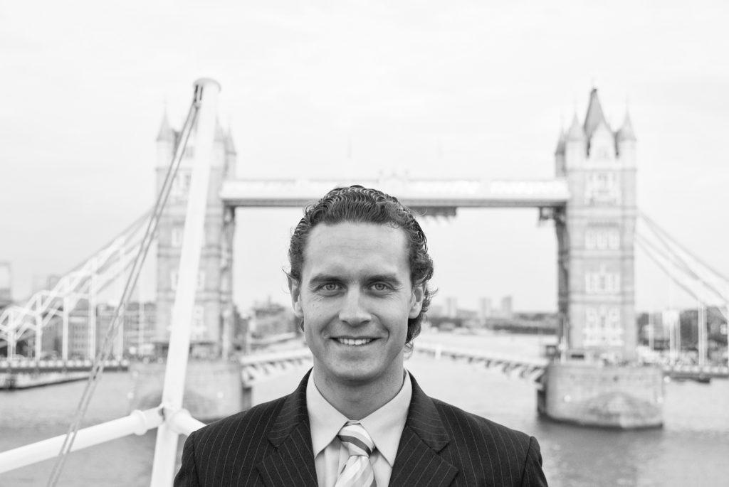 man standing at london bridge
