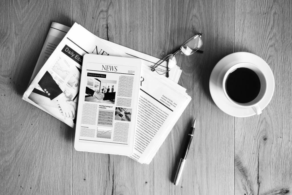 newspapers and coffee